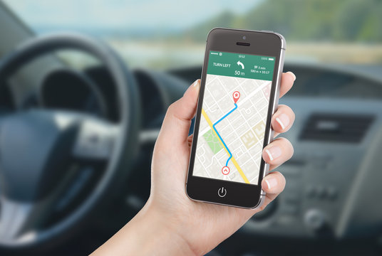 Smartphone with map gps navigation application on the screen in car