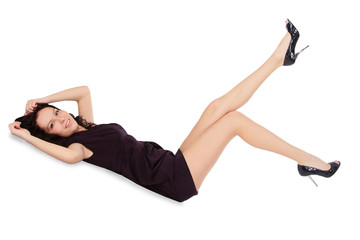 Happy female in black dress lie on the floor