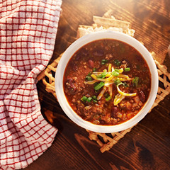 bowl of chili overhead shot with copy space