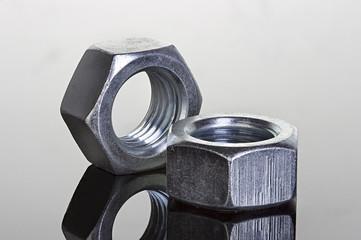 Metal nuts on black background