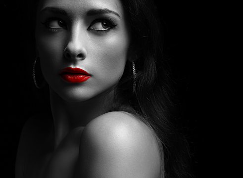 Beautiful mysterious woman in darkness looking dramatic