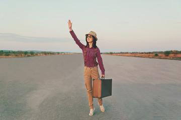 Traveler waves her hand