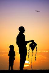 kite festival silhouette at sunset