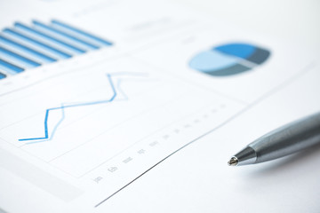 Business data report and chart print. Selective Focus. Blue tone