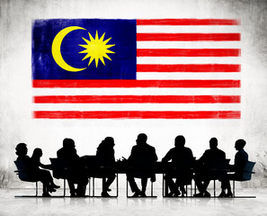 Business People and a Flag of Malaysia
