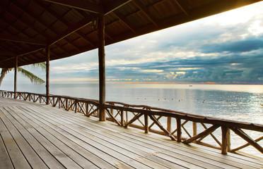 wood terrace in wooden pavillion against peaceful of heaven sea