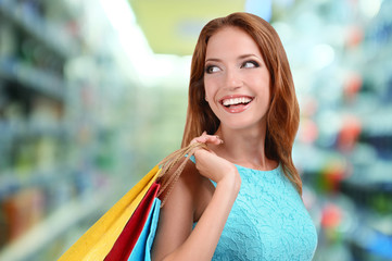 Shopping concept. Beautiful young woman with shopping bags