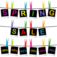 Spring sale concept with photo frames hanging on clothespins