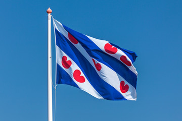 Dutch Frisian flag against a clear blue sky