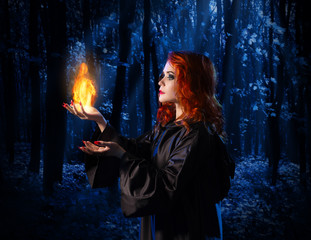 Fototapete - Witch in the moonlight forest with flame