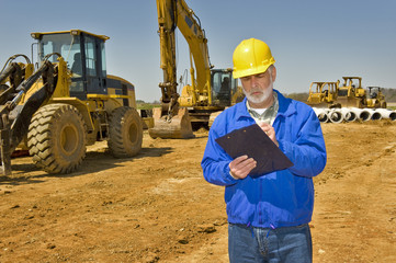 Foreman With Clipboard and Highway Construction Equipment