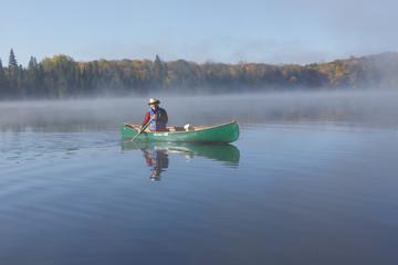 Canoeist on an Autumn Lake