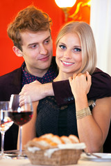 Sweet Young Couple Dating at Restaurant.