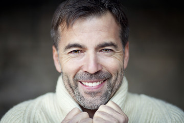 Mature Man Smiling in a forest