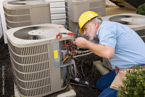 Mature Repairman works On Apartment Air Conditioning Unit\