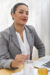 Portrait of attractive businesswoman at coffebreak in office