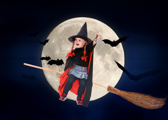 Child witch flying on broomstick