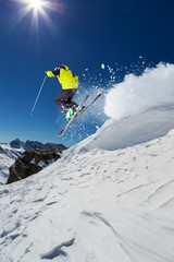 Fototapete - Alpine skier jumping from hill