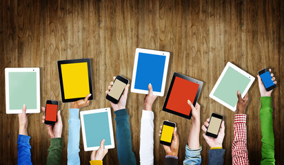 Group of Hands Holding Digital Devices with Copy Space