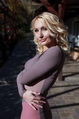 beautiful blonde in dress walks in autumn