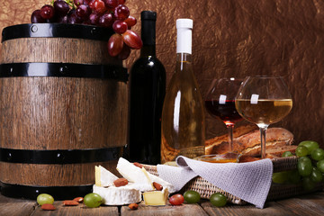 Supper consisting of Camembert and Brie cheese, wine and grapes
