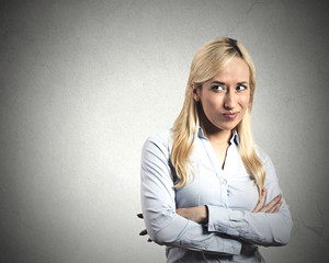 Envy. Portrait young woman with jealous face expression