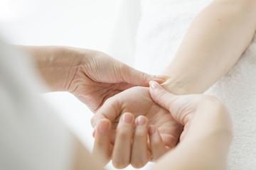 Women undergoing hand massage