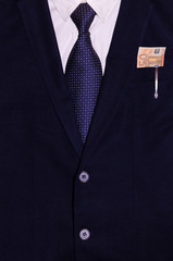 Businessman suit with money and a pen in the pocket