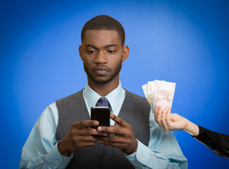 Man texting on smartphone getting paid money blue background