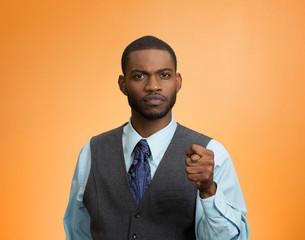 Man showing you get zero nothing hand gesture orange background