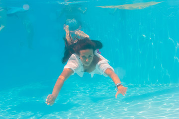 Young woman swimming undewater