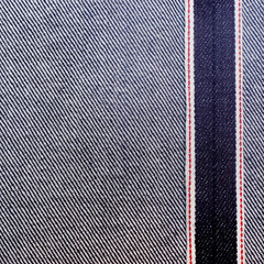 Jeans texture with red seams