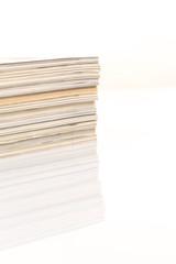 Colorful magazines up close shot on white background
