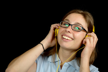 young woman listens to music with headphones