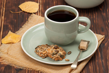 Autumn Concept. Cup Of Tea Or Coffee. Cookies With Seeds. Wooden