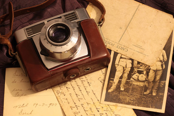 old camera with postcards and photo, about 1940-1945