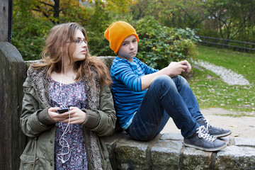 girl and boy with phones