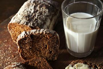 Sliced rye bread and glass of fresh milk