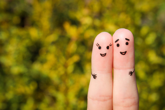 Finger art of a Happy couple. A man and a woman hug