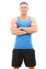 Muscular man posing on white background