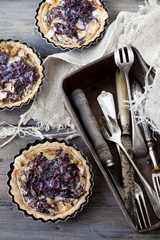 homemade purple cabbage rustic quiche and box with silverware