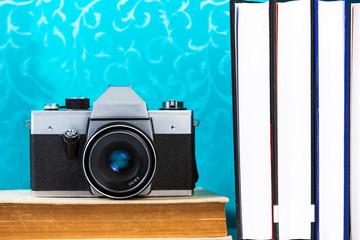 Old analog camera on books