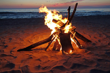 Blazing campfire by Lake Michigan