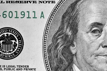 Benjamin Franklin's portrait on one hundred dollar bill.