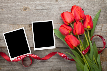 Fresh tulips and blank photo frames