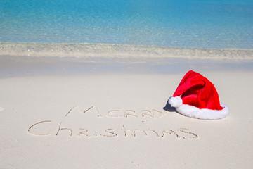Merry Christmas written on tropical beach white sand with xmas