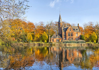 Foto op Canvas Brugge Flemish style building reflecting in Minnewater lake, Bruges, Belgium