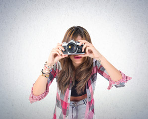 Pretty girl photographing over textured background