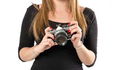 Girl photographing over white background