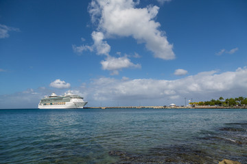 Cruise Ship on Blue Bay Under Nice Clouds